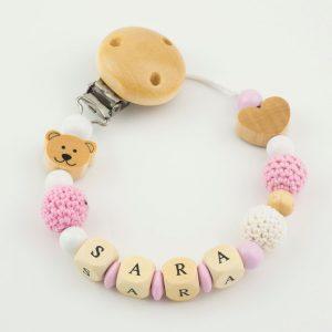 Chupetero ganchillo de dulces colores rosas y blancos